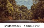 asian men are cycling road bike ... | Shutterstock . vector #558086140