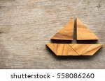 tangram puzzle in sail boat... | Shutterstock . vector #558086260