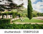 family relax in green park.... | Shutterstock . vector #558091018