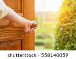 women hand open door knob or... | Shutterstock . vector #558140059