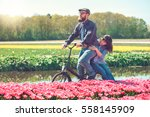 happy loving couple cycling... | Shutterstock . vector #558145909