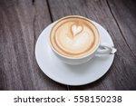 Coffee Latte Art On Wood Table...