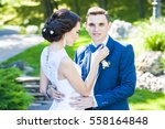 bride and groom in a park....   Shutterstock . vector #558164848