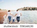 Family Relax On Beach. Family...