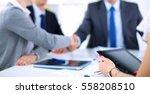 business people shaking hands ... | Shutterstock . vector #558208510