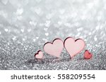 Four Wooden Hearts On Silver...