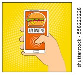 comic phone with halftone... | Shutterstock .eps vector #558223228