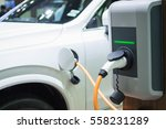 charging an electric car with... | Shutterstock . vector #558231289