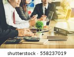 business meeting time.team of... | Shutterstock . vector #558237019