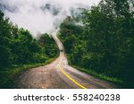 mountain roads and fog cover... | Shutterstock . vector #558240238