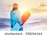 Girl Snowboarder Stands With...