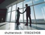 two young businessmen are... | Shutterstock . vector #558265408