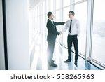 two  business men shaking hands ... | Shutterstock . vector #558265963