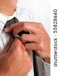 A man making sure his tie sits neatly - stock photo