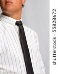 A man wearing a black tie and white, striped shirt - stock photo