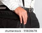 A man walking with a laptop bag over his shoulder - stock photo