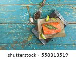 A Piece Of Raw Salmon On Brown...