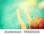 baby sitting near swimming pool. | Shutterstock . vector #558320233