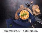 lasagna in baking dish on an... | Shutterstock . vector #558320386