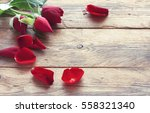valentine's day three red roses ... | Shutterstock . vector #558321340