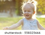 cheerful little girl in a... | Shutterstock . vector #558325666