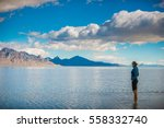 tourist standing in a shallow... | Shutterstock . vector #558332740