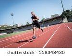 sport man running on a racetrack | Shutterstock . vector #558348430