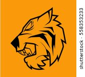 tiger head on yellow background   Shutterstock .eps vector #558353233