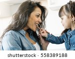 mother eating chocolate with... | Shutterstock . vector #558389188