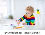 cute little boy doing homework  ... | Shutterstock . vector #558435454
