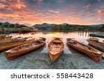 A Fiery Sunset Over Boats On...