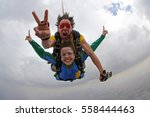 skydiving tandem happiness | Shutterstock . vector #558444463