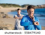 young couple on beach checking... | Shutterstock . vector #558479140