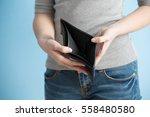 woman with no money in her... | Shutterstock . vector #558480580