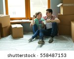 couple moving in house sitting... | Shutterstock . vector #558487153