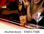 three exotic cocktails in rays... | Shutterstock . vector #558517588