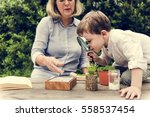 little kid experimenting... | Shutterstock . vector #558537454