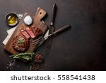 grilled ribeye beef steak ... | Shutterstock . vector #558541438