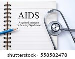 Small photo of Stethoscope on notebook and pencil with AIDS (Acquired Immune Deficiency Syndrome) words as medical concept.