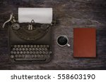 vintage typewriter and coffee... | Shutterstock . vector #558603190