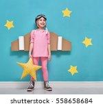 little child girl in an... | Shutterstock . vector #558658684
