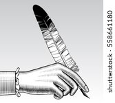 woman's hand with a pen.... | Shutterstock .eps vector #558661180