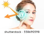 beautiful woman and sunscreen... | Shutterstock . vector #558690598