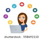 young woman using a laptop... | Shutterstock .eps vector #558692110
