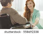 supportive young nurse looking... | Shutterstock . vector #558692338