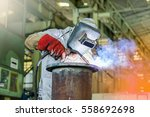 Small photo of welder man welding pipe by mig weld in factory