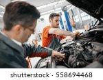car mechanic working at...   Shutterstock . vector #558694468