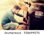 man changing wheel on the car... | Shutterstock . vector #558699070
