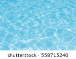 water in swimming pool rippled... | Shutterstock . vector #558715240