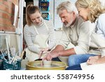 mature couple with teacher in...   Shutterstock . vector #558749956